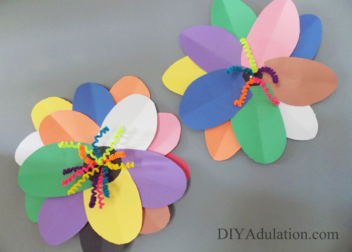 Paper flowers hanging on a wall
