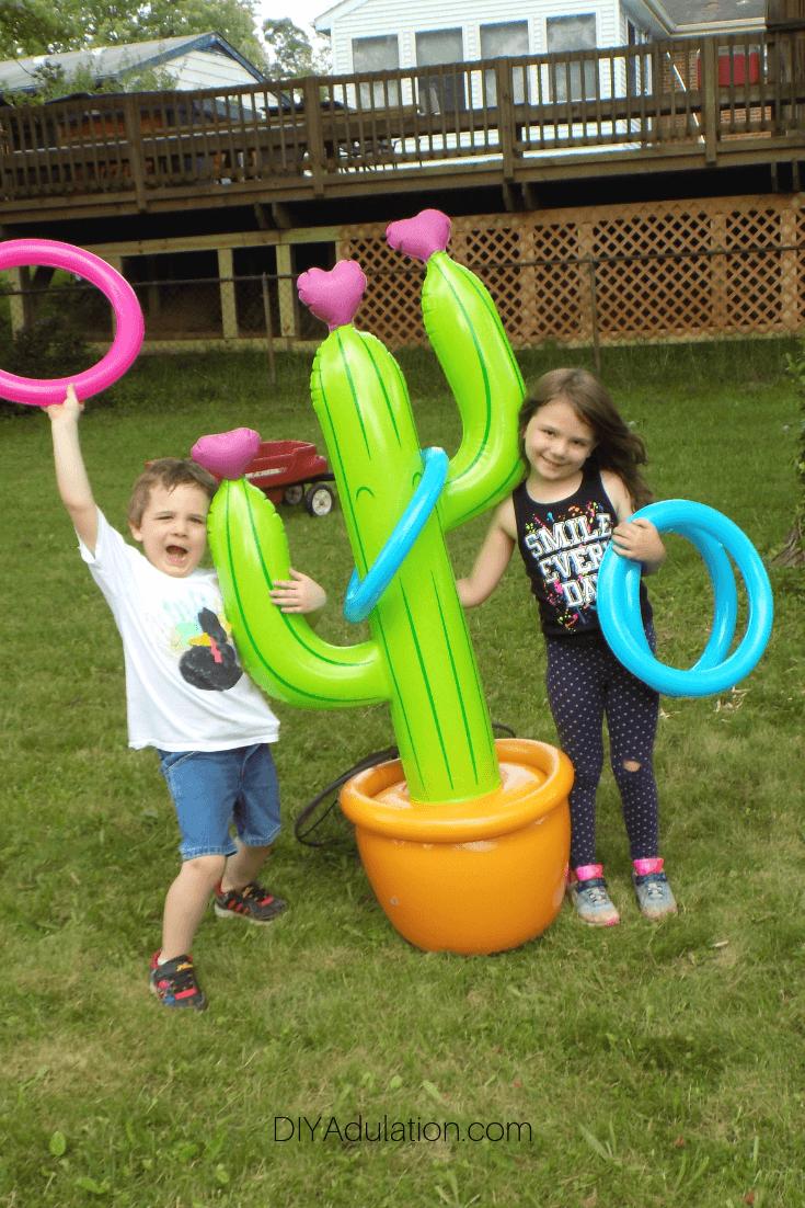 Kids Next to Cactus Ring Toss