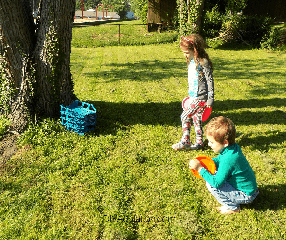 Kids Playing Disc Toss Game