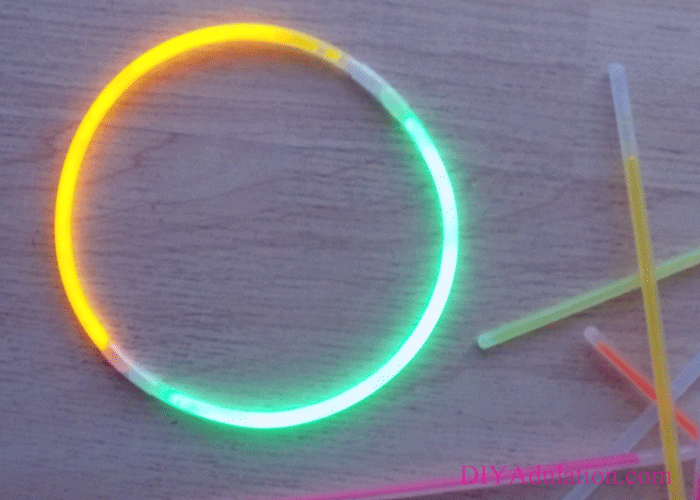 Glow Sticks on Wood Background