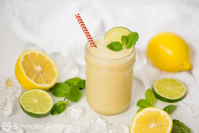 Lemon iced tea smoothie next to lemons