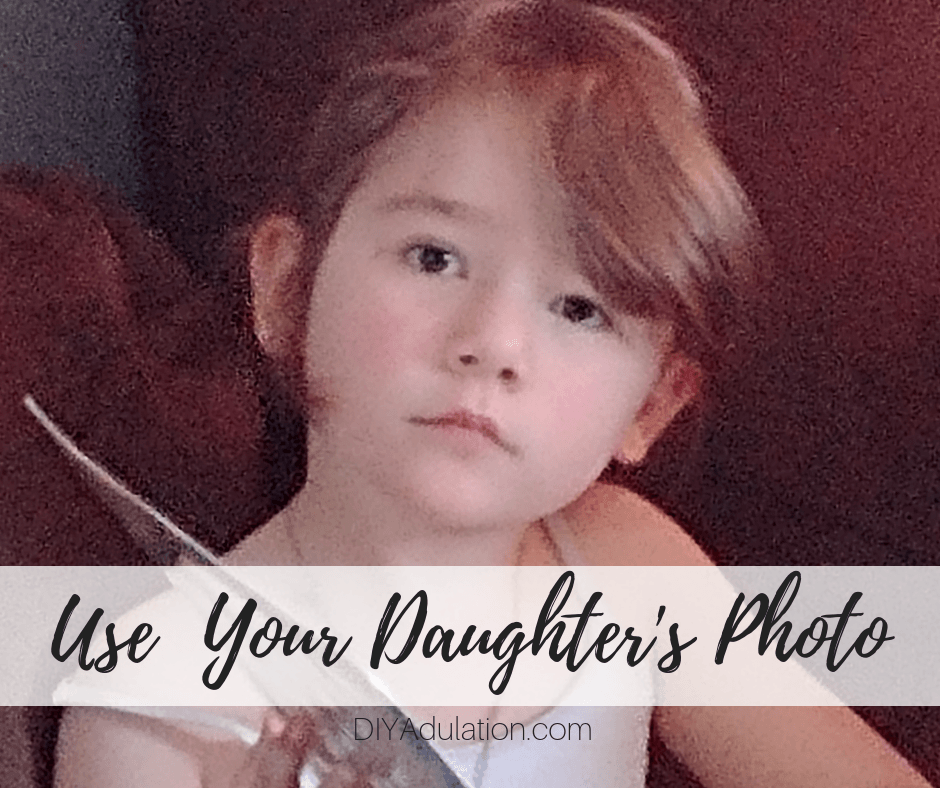 Little girl looking at camera with text overlay - Use Your Daughters Photo