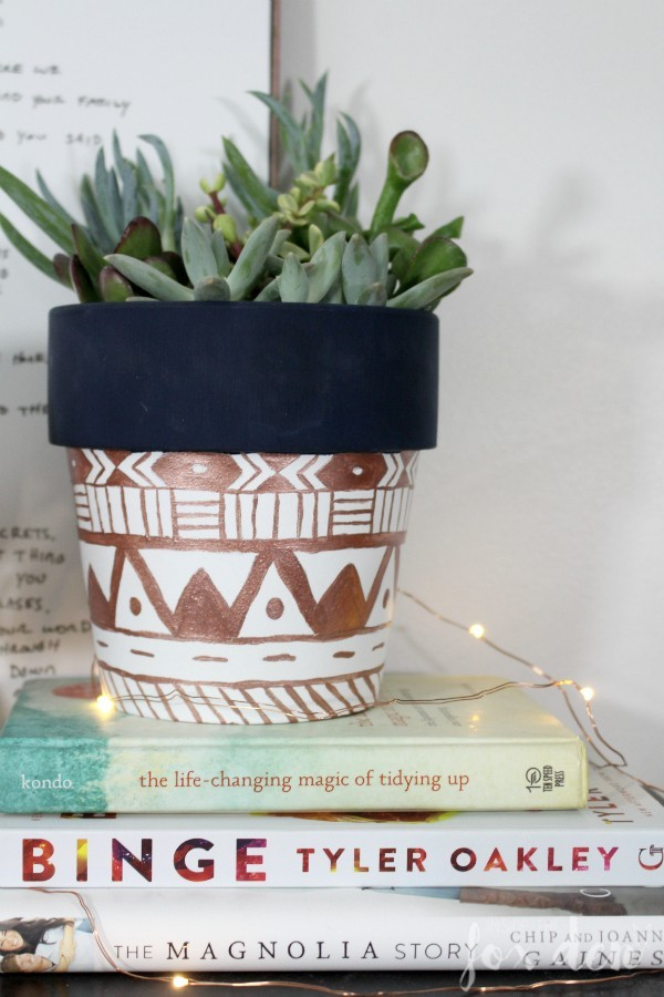 metallic planter on stack of books