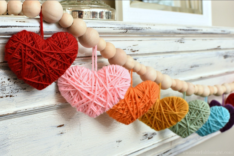 Close up of multi-colored yarn heart garland
