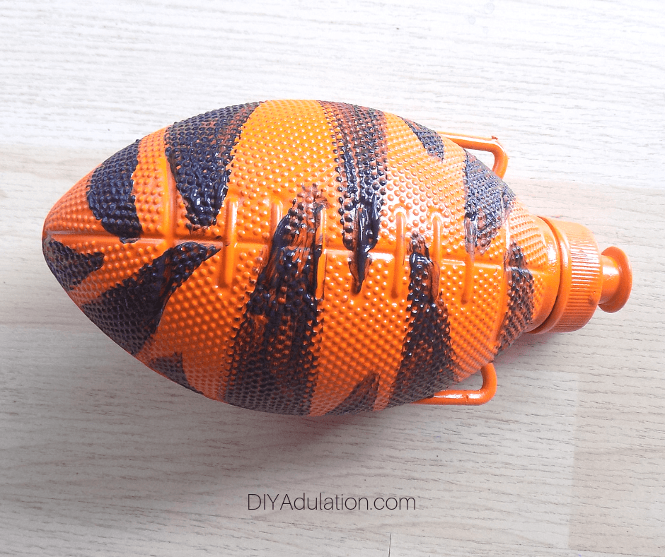 Orange Spray Painted Football Water Bottle with Black Stripes