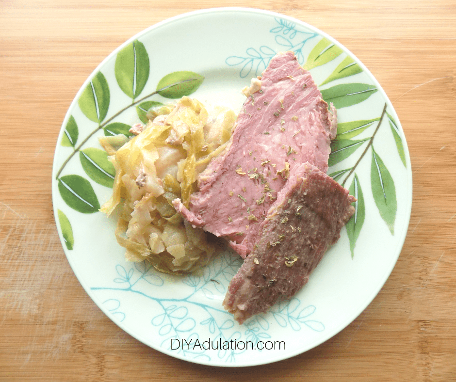 Overhead of Corned Beef next to Cabbage on Plate