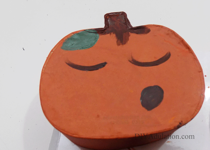 Close up of painted pumpkin with a face