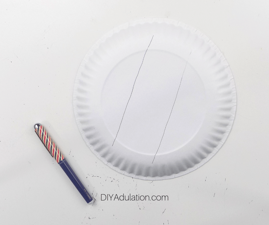 Paper Plate with Lines on It next to Pen