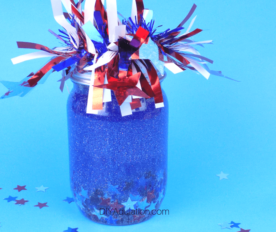 Patriotic Glitter Sensory Jar on Blue Background