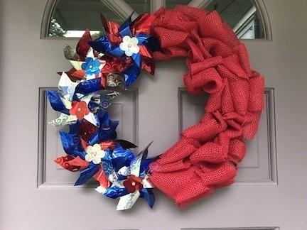Patriotic Pinwheel Wreath Hanging on Door