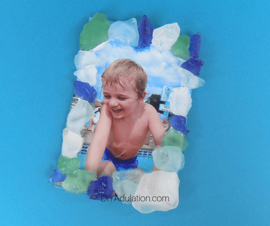 Sea Glass Picture Frame on Blue Background