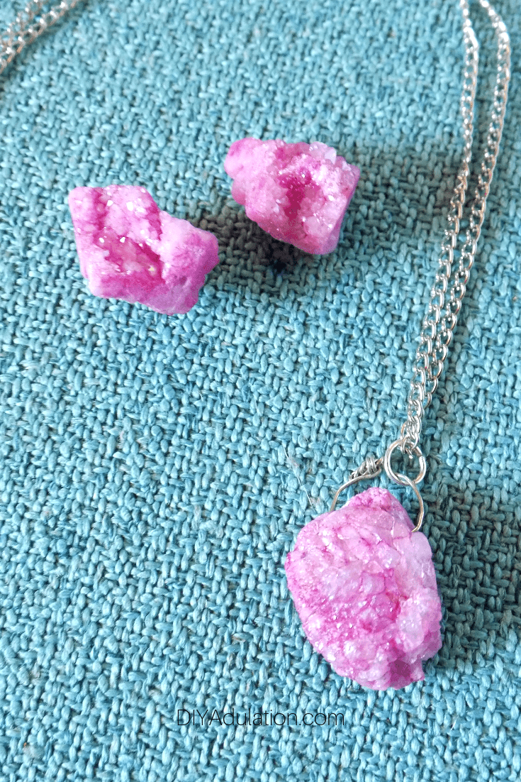 Pink Druzy Necklace and Earrings on Teal Background