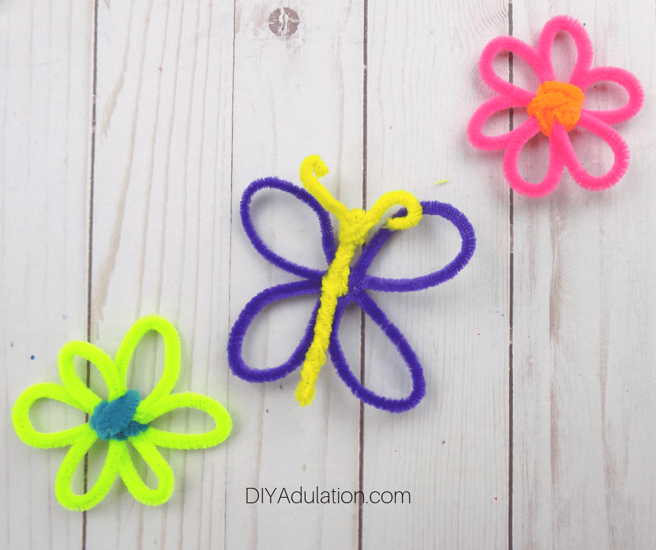 Pipe Cleaner Butterfly next to Flowers