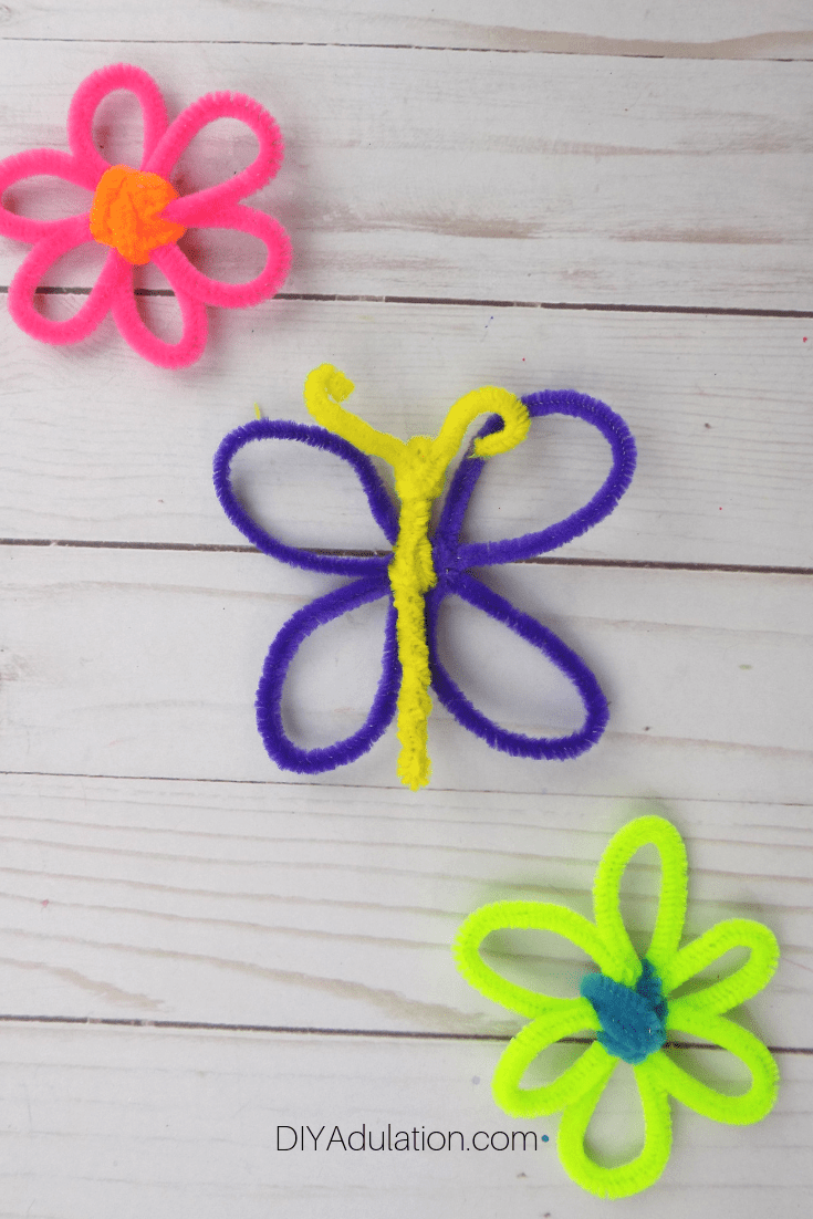 Pipe Cleaner Butterfly next to Pipe Cleaner Flowers