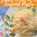 Plate of Pasta on Floral Background with text overlay - Simple and Delicious Garlic White Wine Seafood Pasta