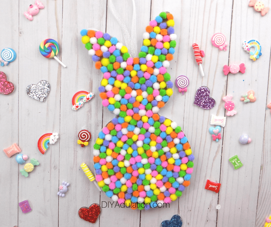 Pompom Bunny on Candy Background