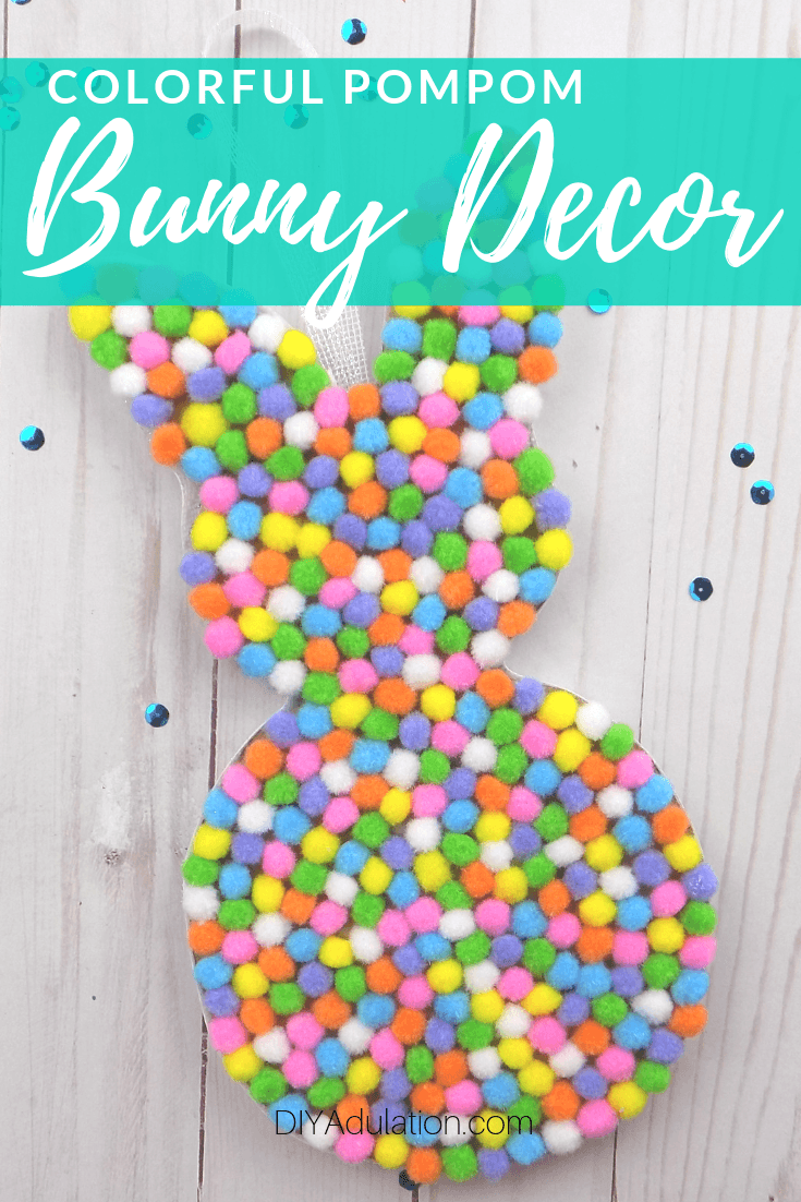 Pompom Easter Bunny on with Sequins with text overlay - Colorful Pompom Bunny Decor