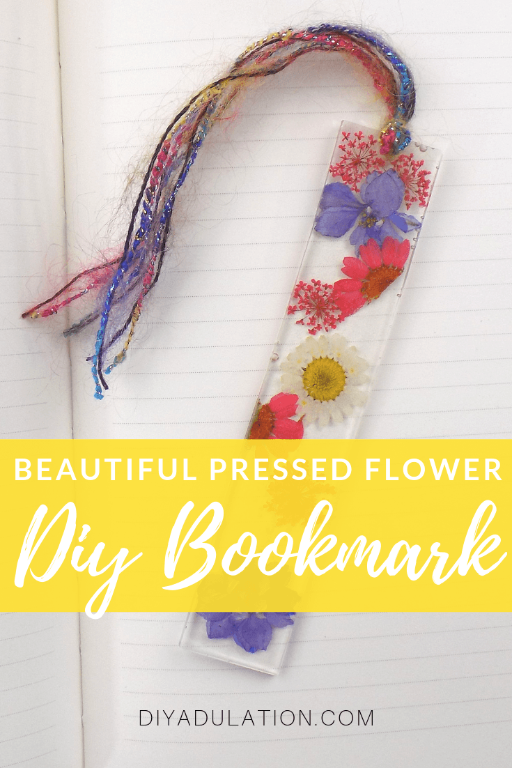 Pressed Flower Bookmark on Lined Journal with text overlay - Beautiful Pressed Flower DIY Bookmark