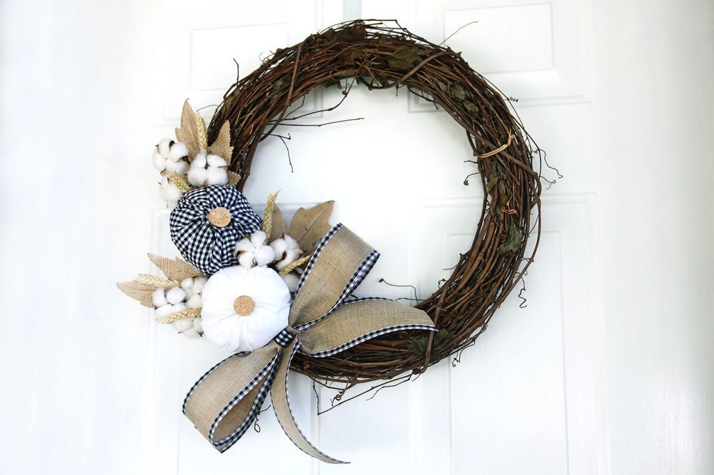 Grapevine wreath with pumpkins, cotton, and ribbon