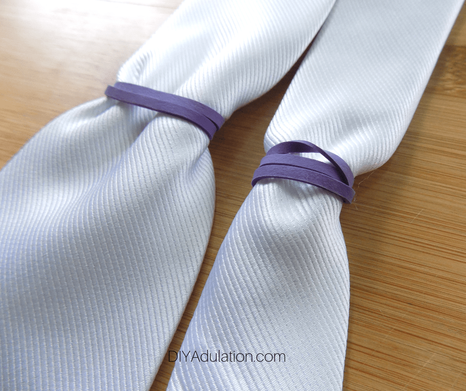 Purple Rubber Bands on White Tie