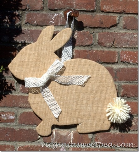Burlap bunny hanging on brick wall