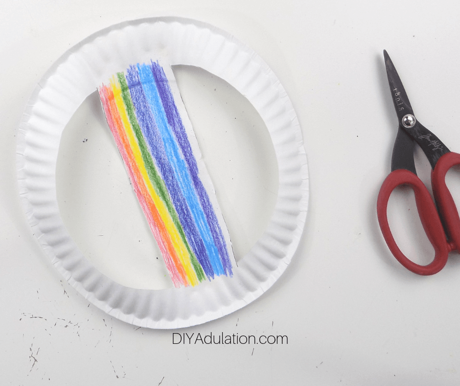 Rainbow Colored on Center of Paper Plate Next to Scissors