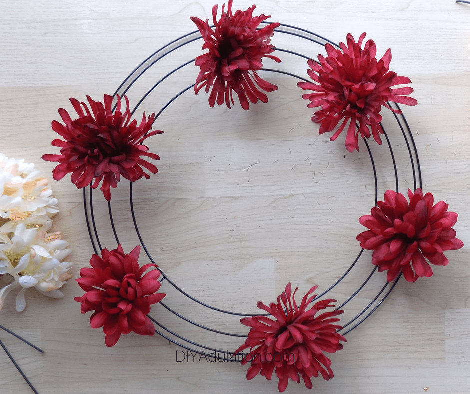 Red Flowers on a Wire Wreath Form