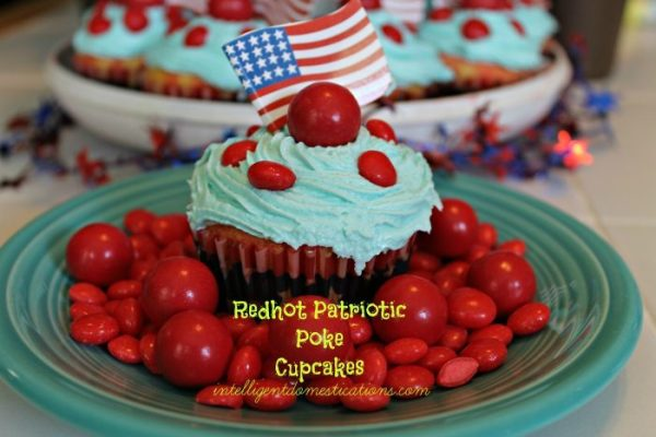 Redhot Patriotic Poke Cupcake on Plate surrounded by Red Hots and Fireball candies