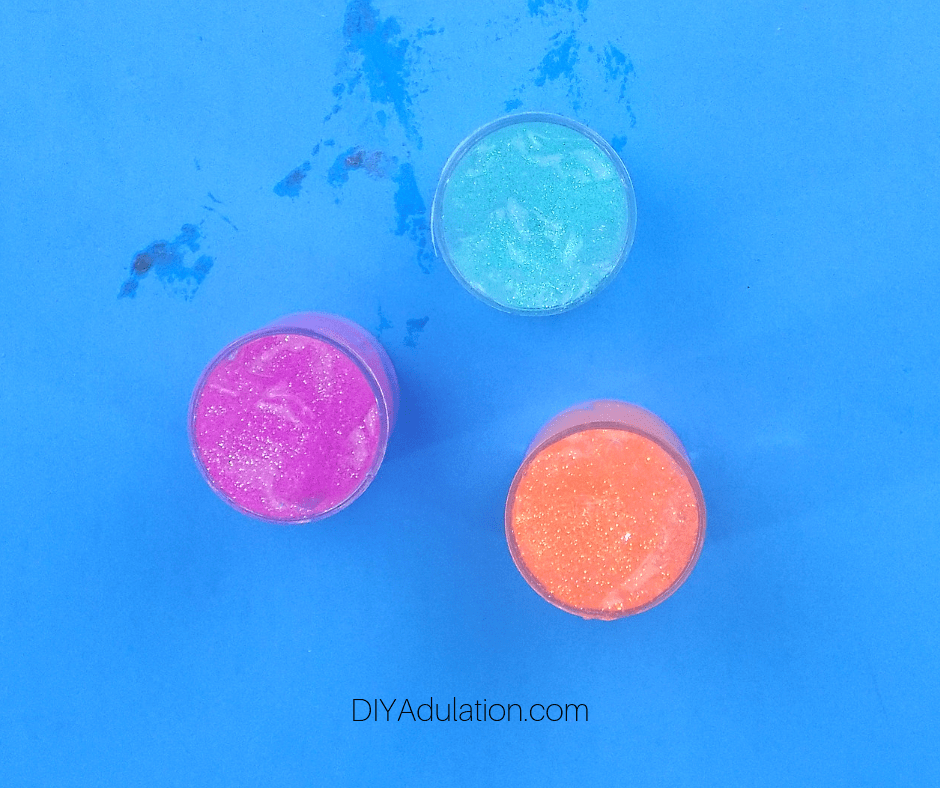 Small Containers Filled with Body Glitter Gel