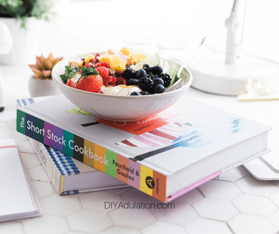 Stack of Cookbooks with Fruit on top