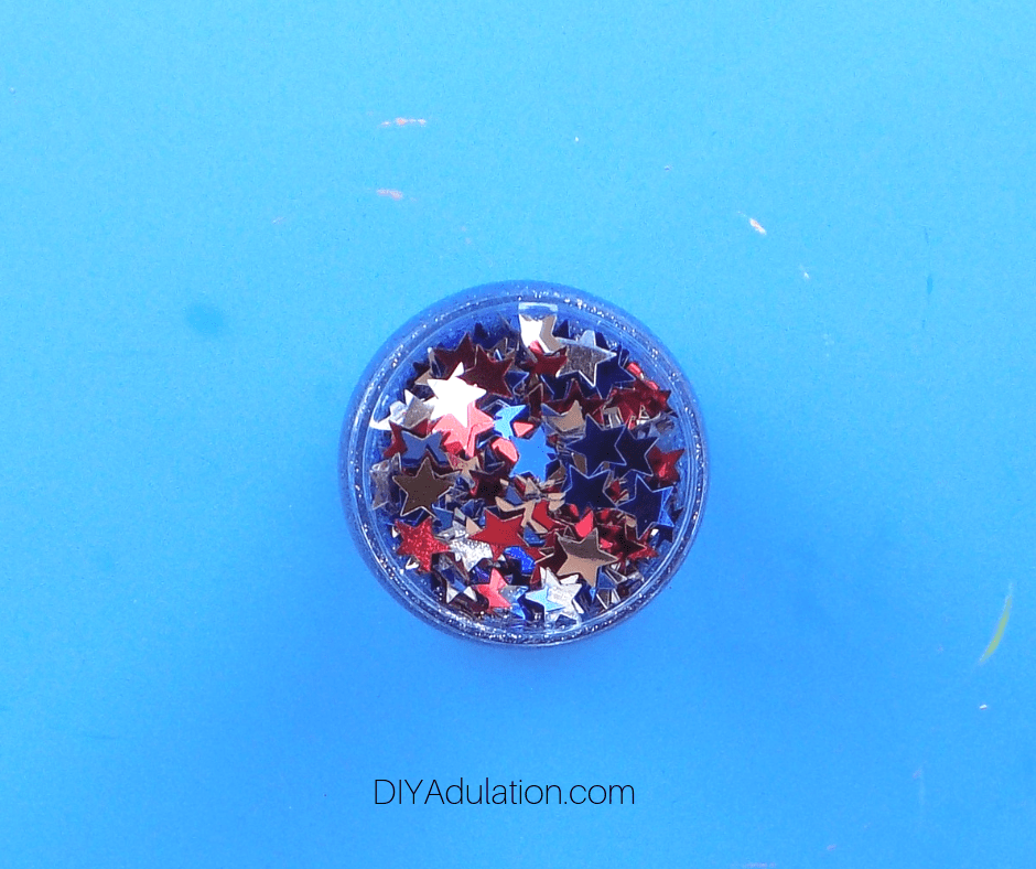 Stars Confetti on Mixture in Jar