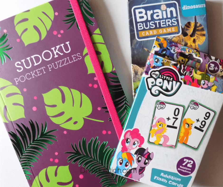 Sudoku Puzzle Book next to Card Games