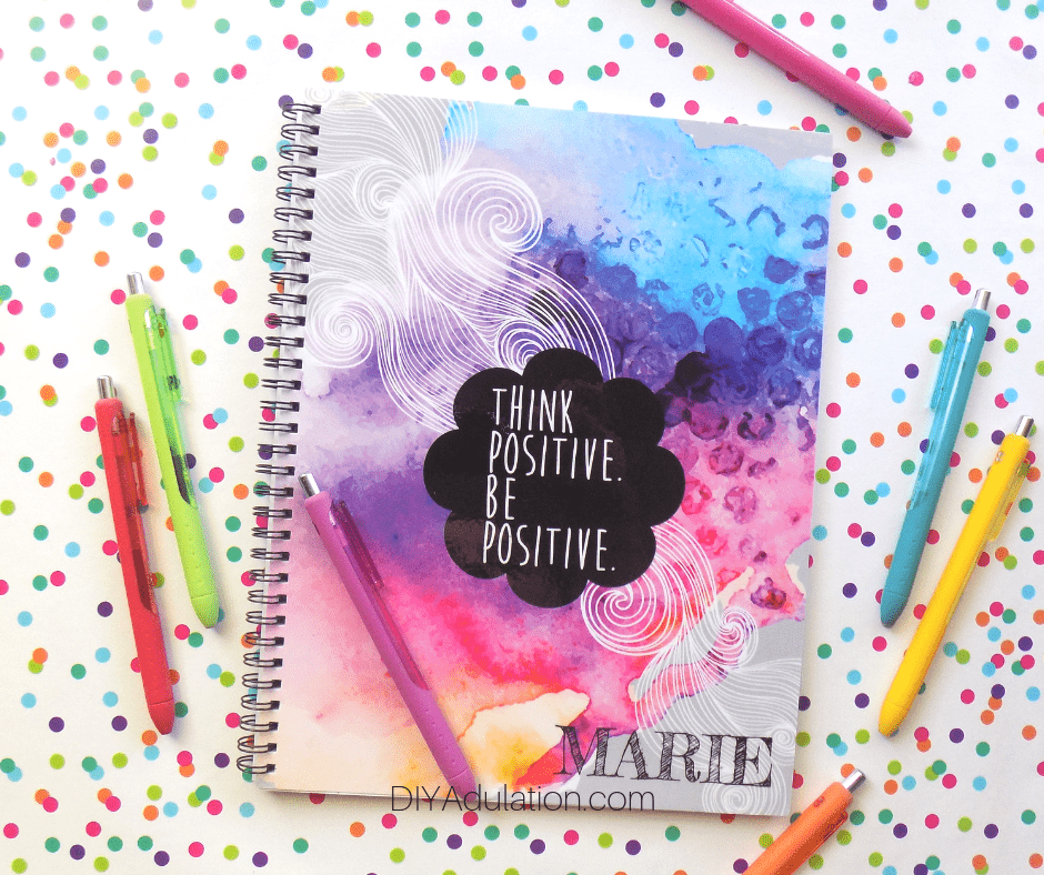 Think Positive Be Positive Journal next to Pens