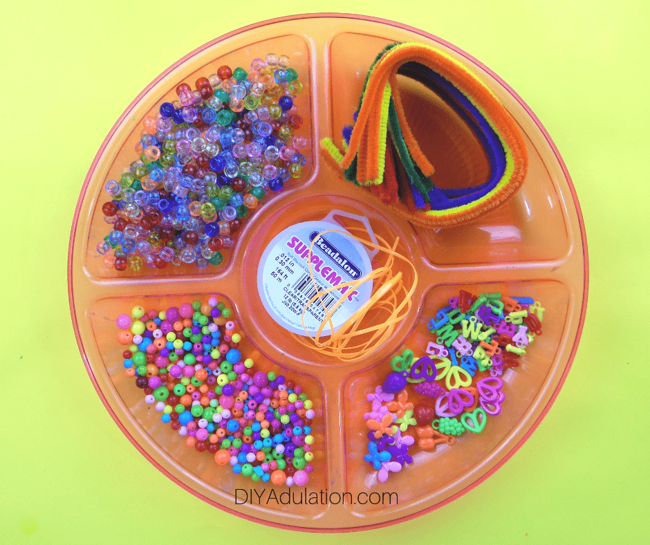 Tray with beads and pipe cleaners in it