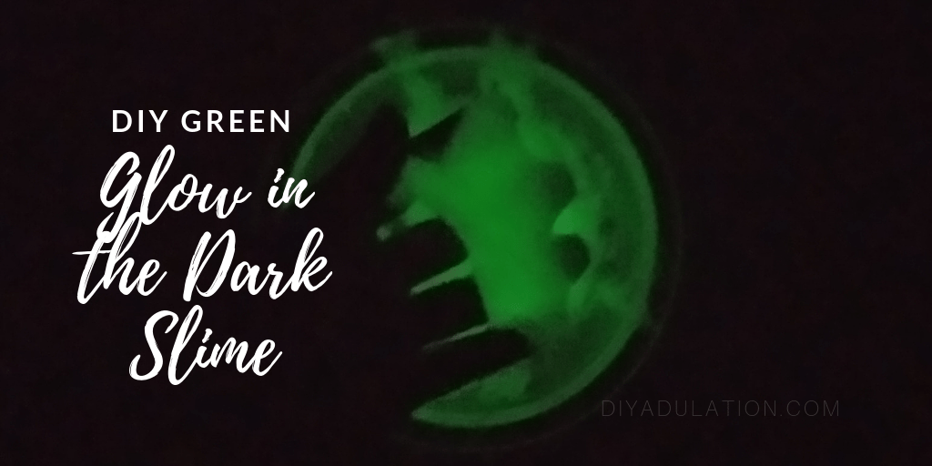 Hand in Glowing Slime with text overlay: DIY Green Glow in the Dark Slime