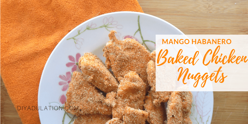 Plate of Chicken Nuggets on Orange Towel with text overlay - Mango Habanero Baked Chicken Nuggets
