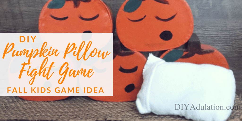Close Up Pyramid of painted pumpkins with text overlay: DIY Pumpkin Pillow Fight Game Fall Kids Game Idea