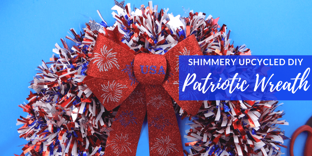 patriotic garland wreath with bow and stars on door with text overlay - Shimmery Upcycled DIY Patriotic Wreath