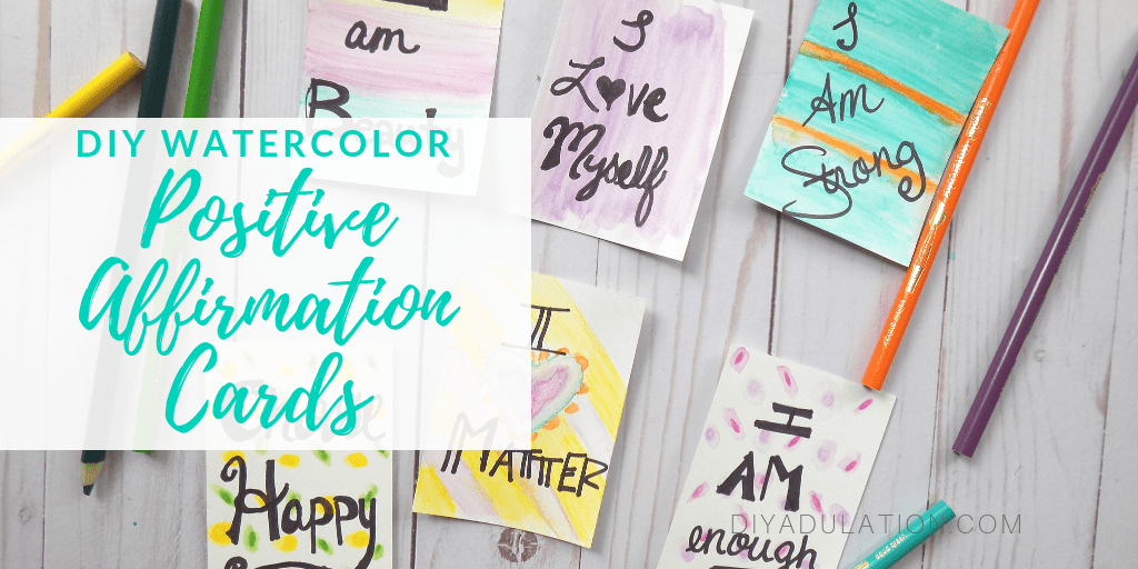 Positive Affirmation Cards Next to Pencils and Watercolor Cards with Text Overlay - DIY Watercolor Positive Affirmation Cards