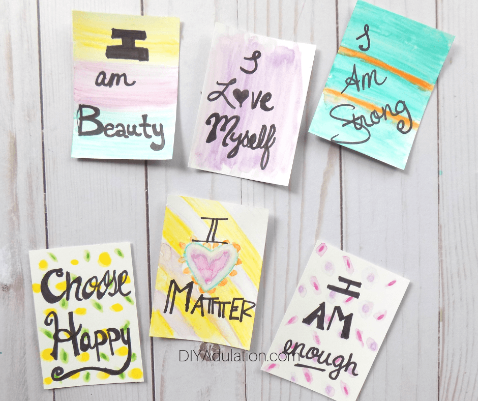 Watercolor Affirmation Cards on Wood Background