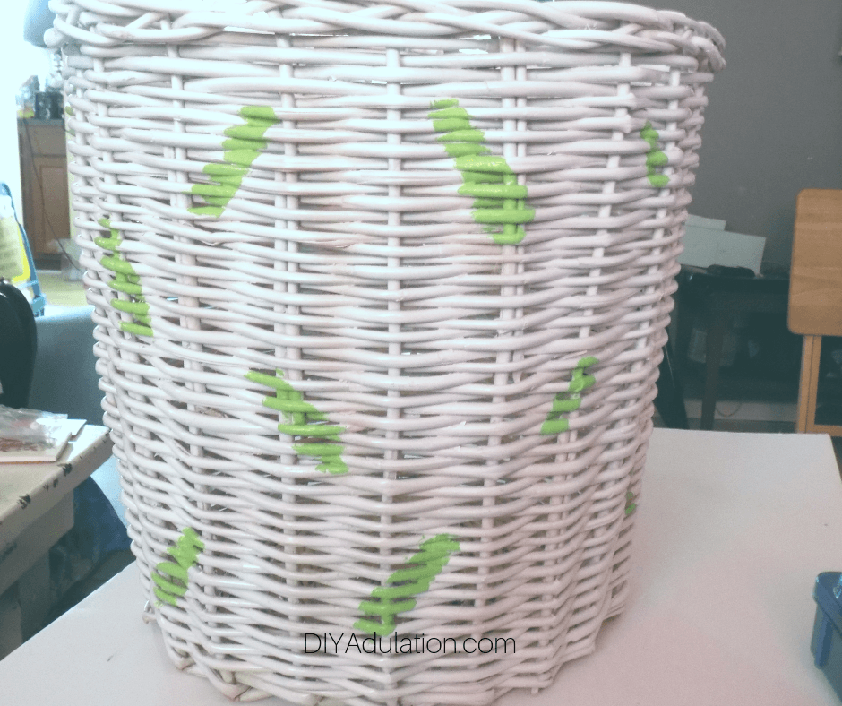 White Basket with Green Sprinkles Painted on It