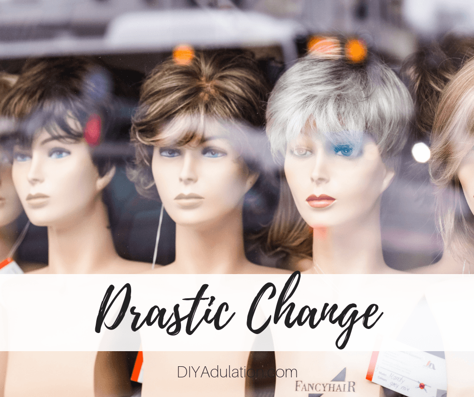 Wigs on Mannequin heads in window with text overlay - Drastic Change