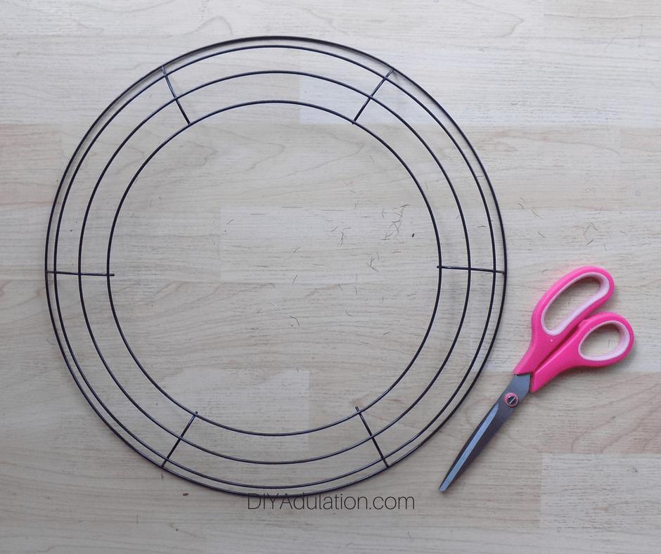 Wire Wreath Form next to Pink Scissors