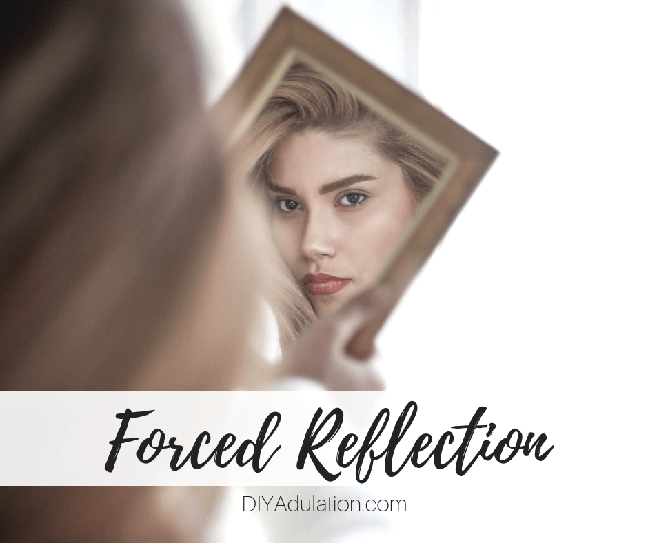 Woman Looking in Mirror with text overlay_ Forced Reflection