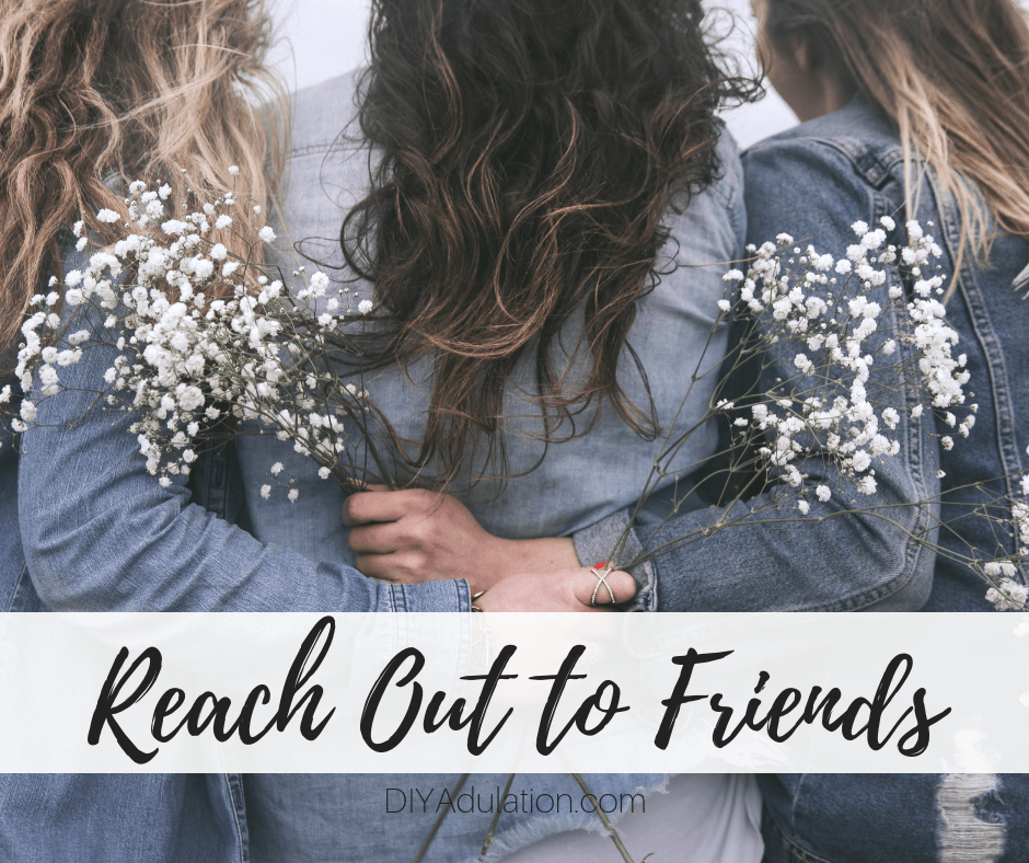 Women with Arms Around Each Other with text overlay_ Reach Out to Friends