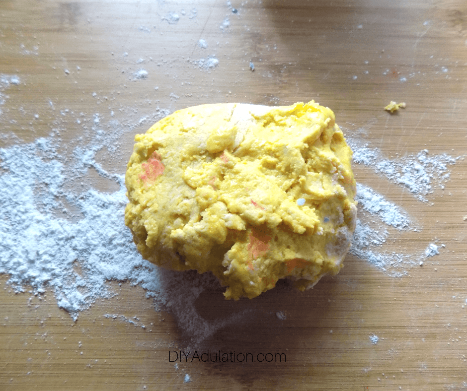 Yellow Play Dough on Floured Surface