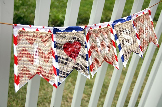 burlap and chevron fabric banner on white fence