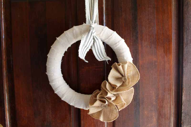 Small off-white wreath with burlap flowers