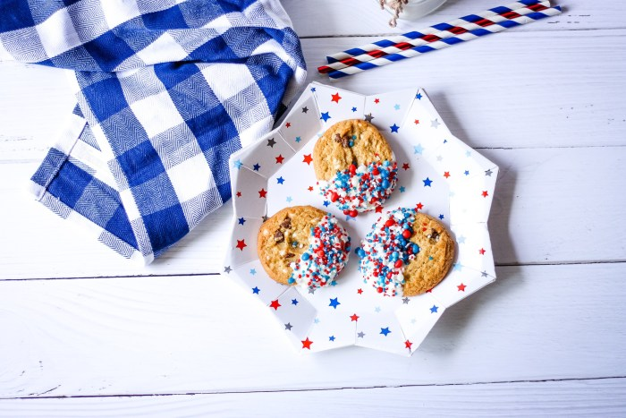 Chocolate dipped cookies with red white and blue sprinkles