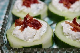 Close up of bacon and cream cheese topped cucumber slice